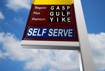Road Haulage Costs - Fuel price board against blue sky